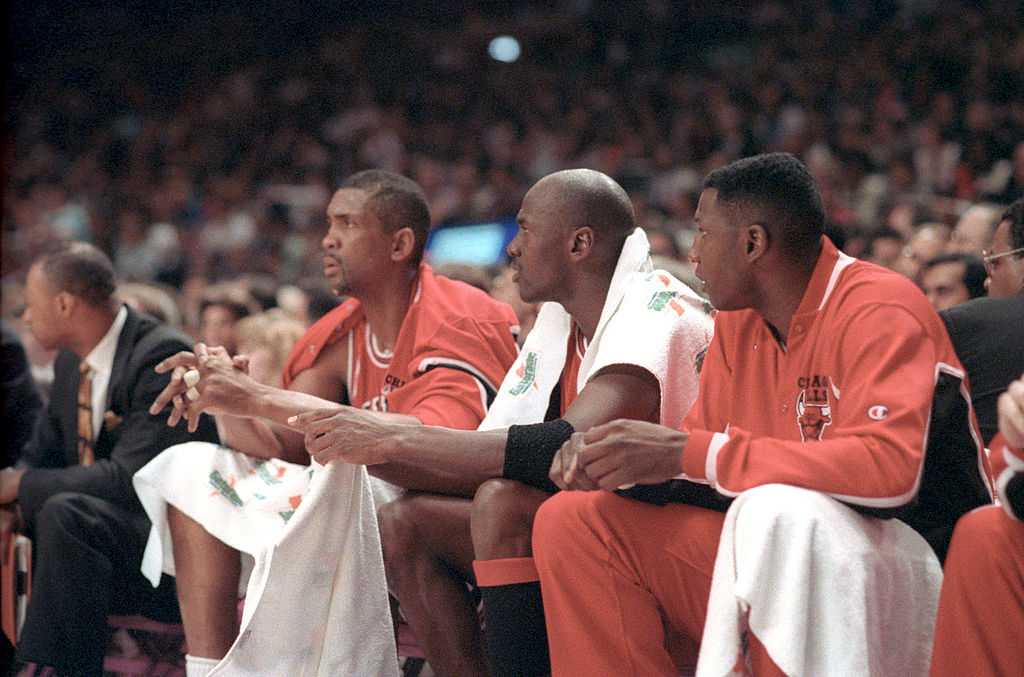 Bill Cartwright and Michael Jordan sit on the Chicago Bulls bench
