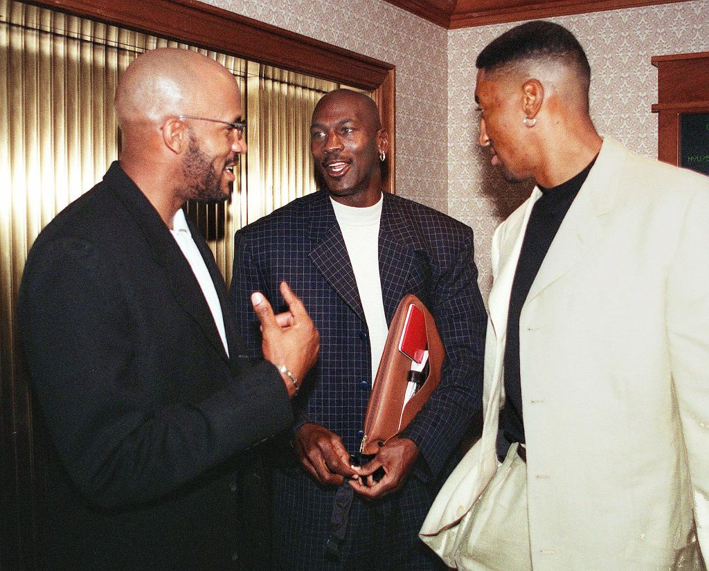 Chicago Bulls Michael Jordan (C), Scottie Pippen (R), and Ron Harper get together before a meeting