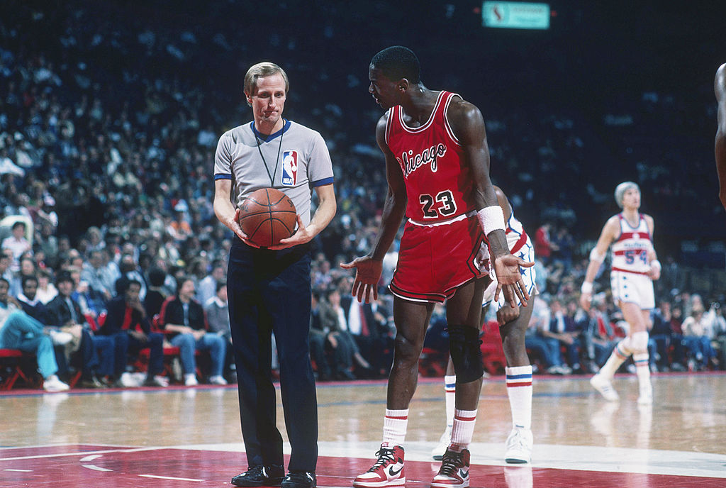 Chicago Bulls' forward Michael Jordan shrugs his shoulders as he talks to a referee