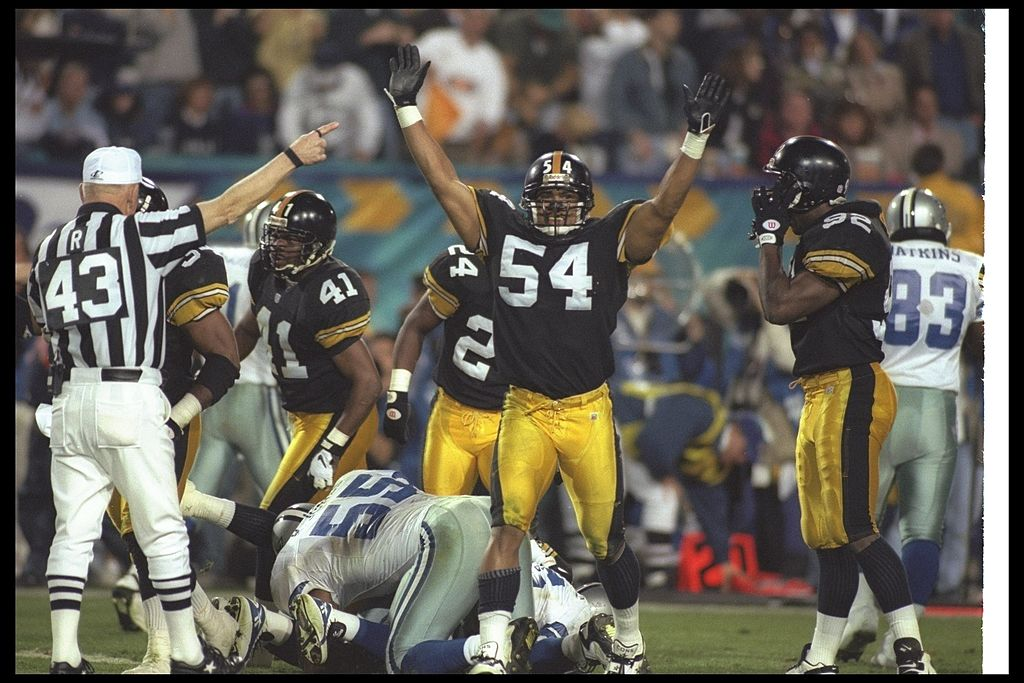 Linebacker Donta Jones of the Pittsburgh Steelers celebrates after a fumble recovery during game against the Dallas Cowboys at Super Bowl XXX