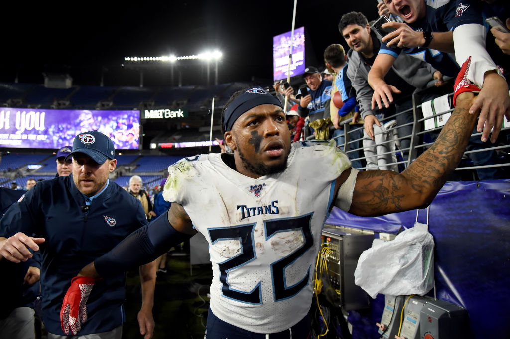 Derrick Henry of the Tennessee Titans celebrates with fans after defeating the Baltimore Ravens in the AFC Divisional Playoff game