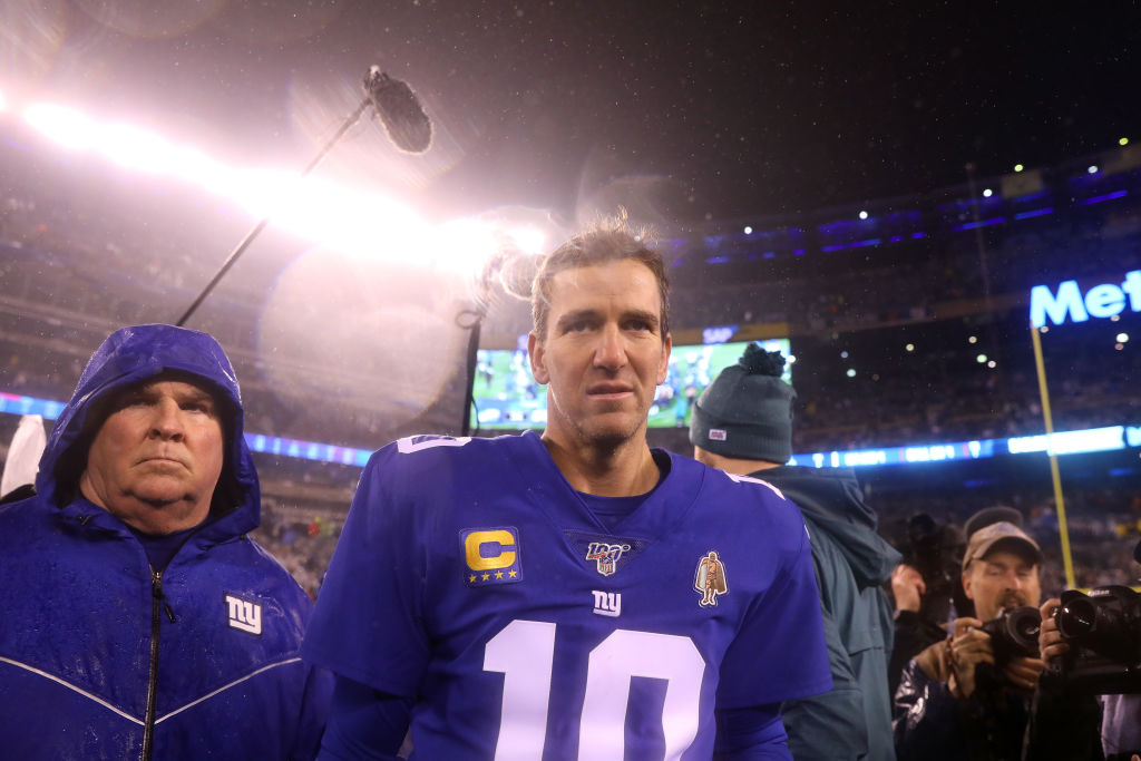 Eli Manning of the New York Giants walks off the field