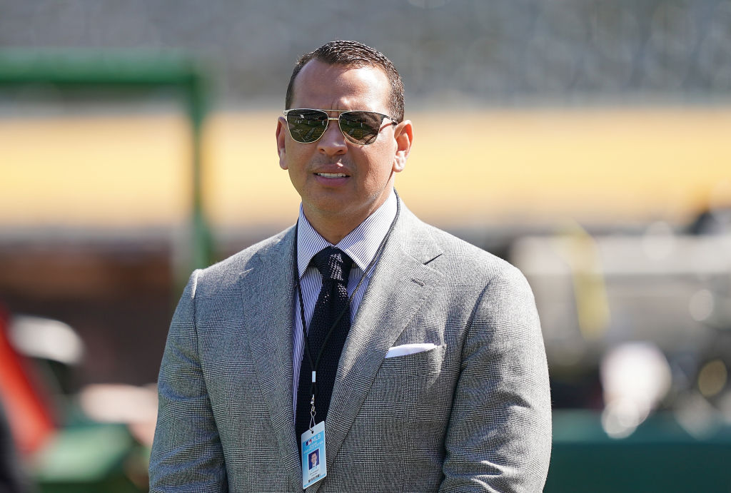 Baseball analyst and former player Alex Rodriguez looks on