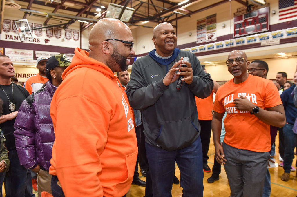 Tarence Wheeler (L) and former NBA Player Derrick Coleman speak at the 2019 All-Star Giveback: Thanksgiving Edition