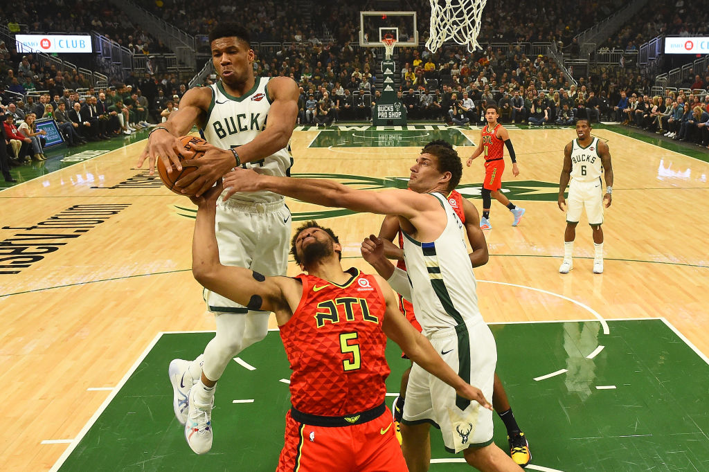 Giannis Antetokounmpo and the Bucks have a high-powered offense, but their defensive approach is what might make them championship frontrunners.
