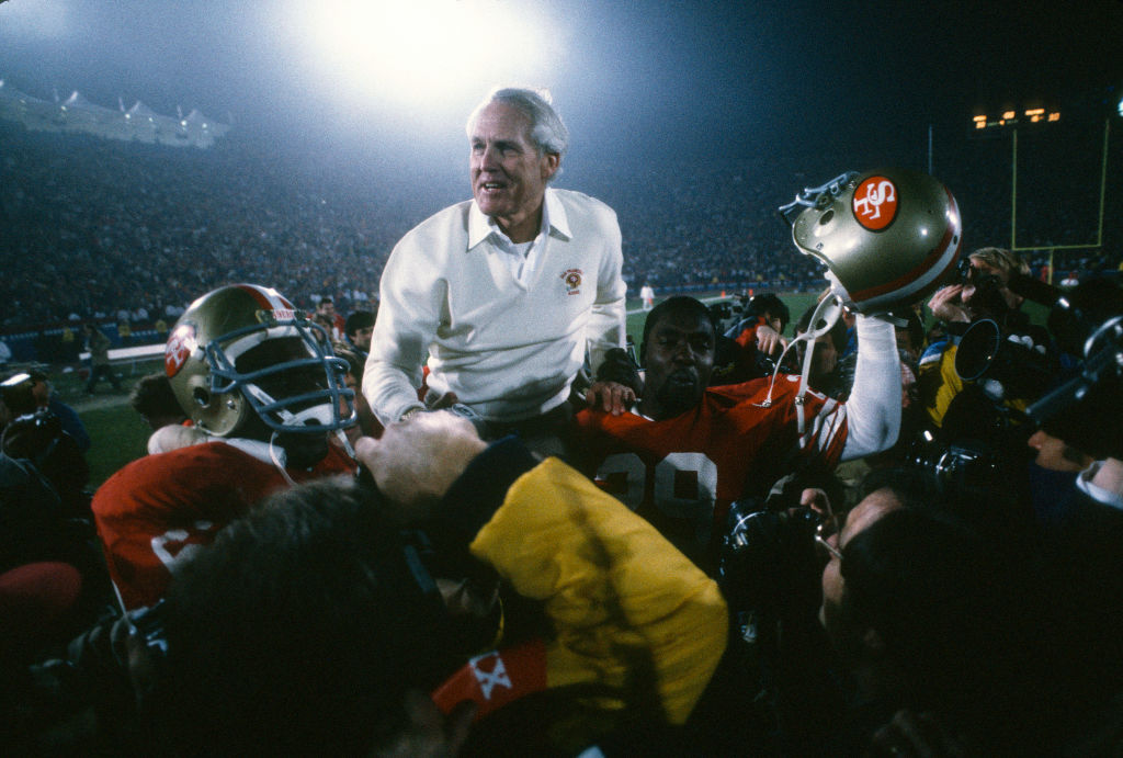 Head Coach Bill Walsh of the San Francisco 49ers is carried off the field after winning Super Bowl XIX