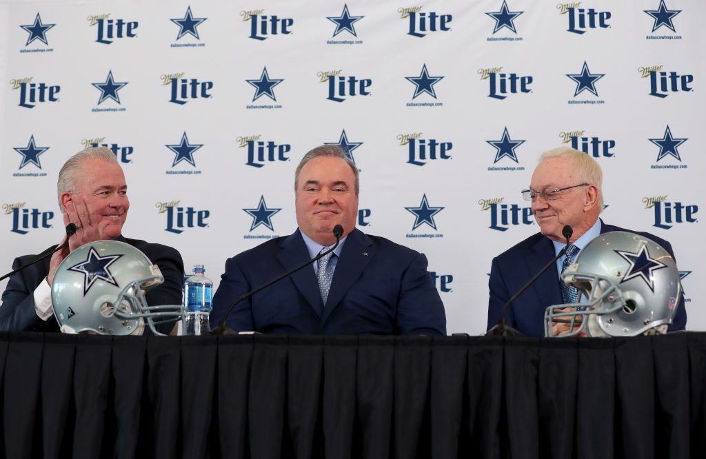 (L-R) Executive Vice President Stephen Jones, head coach Mike McCarthy, and Dallas Cowboys owner Jerry Jones talk with the media