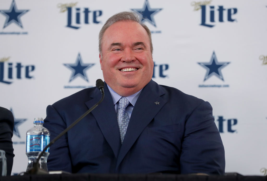 Head coach Mike McCarthy of the Dallas Cowboys talks with the media