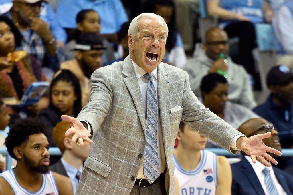 Head coach Roy Williams of the North Carolina Tar Heels reacts following a play