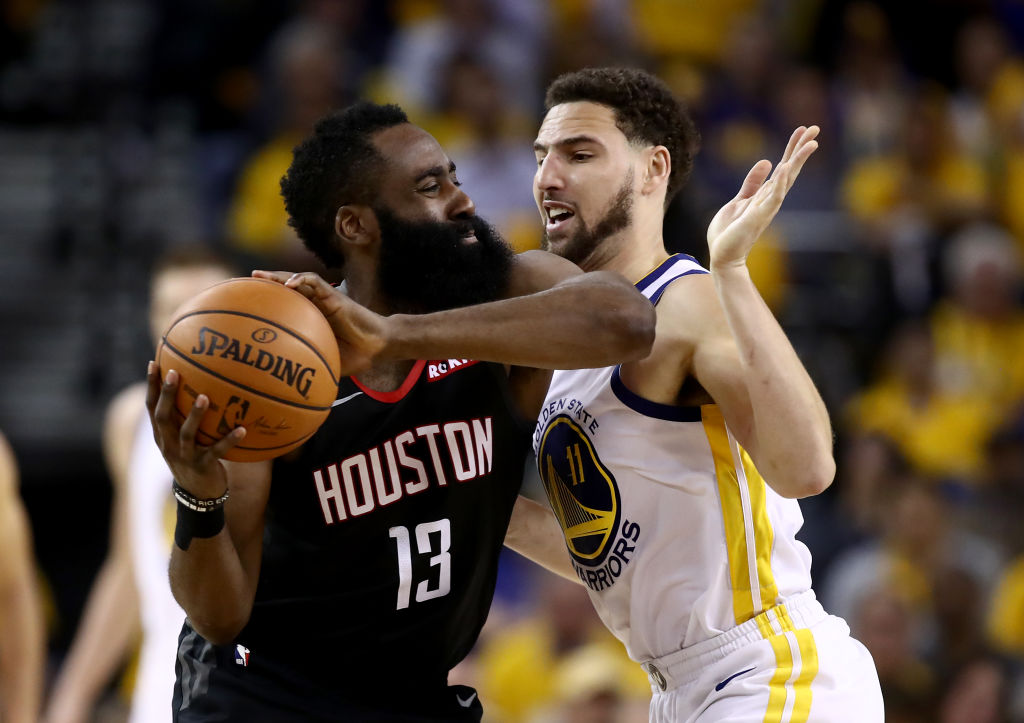 James Harden of the Houston Rockets is guarded by Klay Thompson of the Golden State Warriors