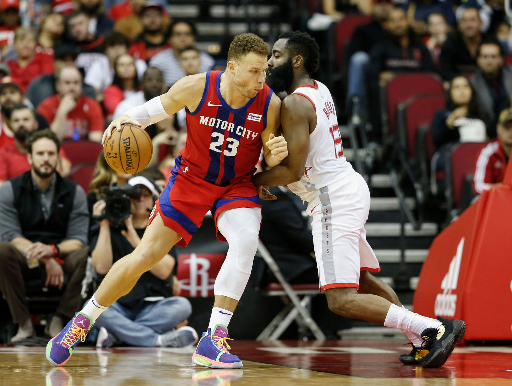 Blake Griffin of the Detroit Pistons drives to the basket, defended by James Harden