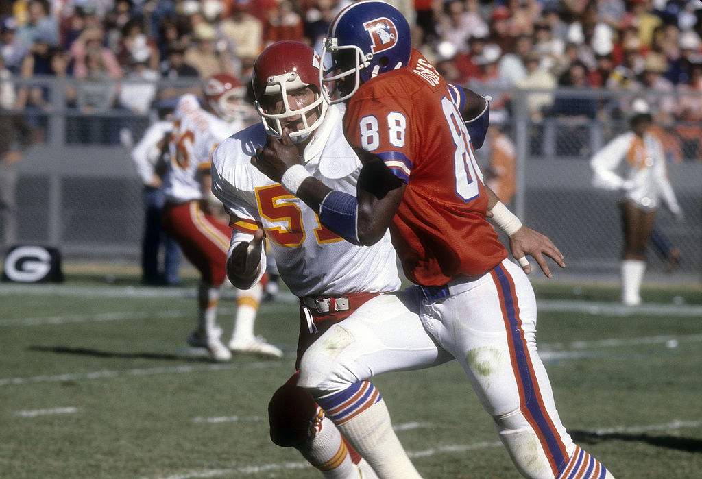 Jim Lynch of the Kansas City Chiefs guards Riley Odoms of the Denver Broncos during an NFL football game in 1977