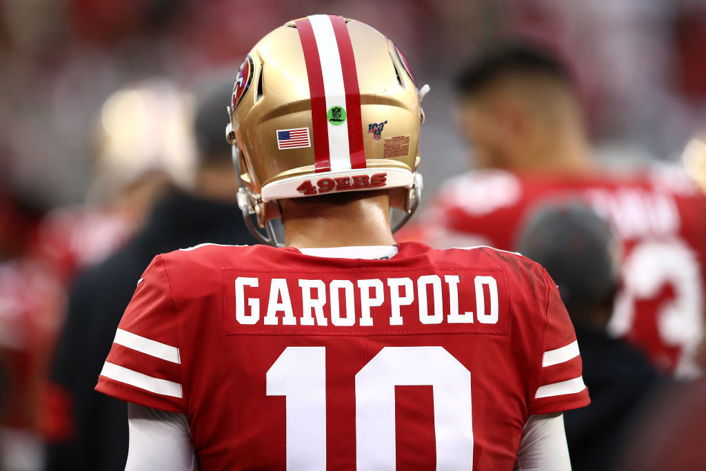 Jimmy Garoppolo of the San Francisco 49ers stands on the sidelines