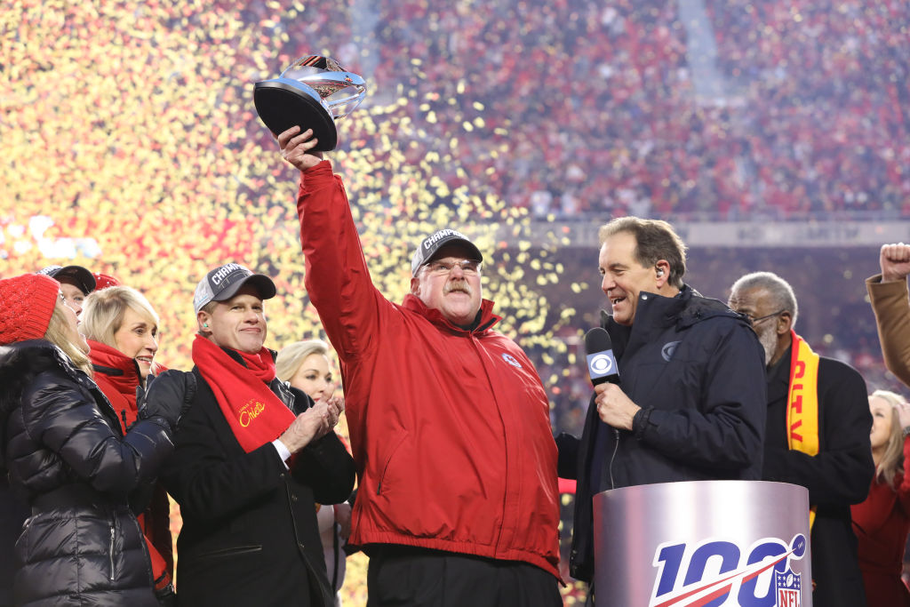 Kansas City Chiefs head coach Andy Reid lifts the Lamar Hunt Trophy over his head after the AFC Championship game