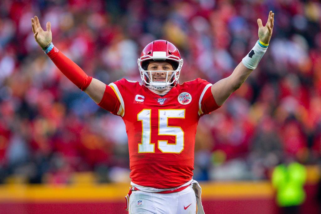 Kansas City Chiefs quarterback Patrick Mahomes celebrates after a play against the Titans