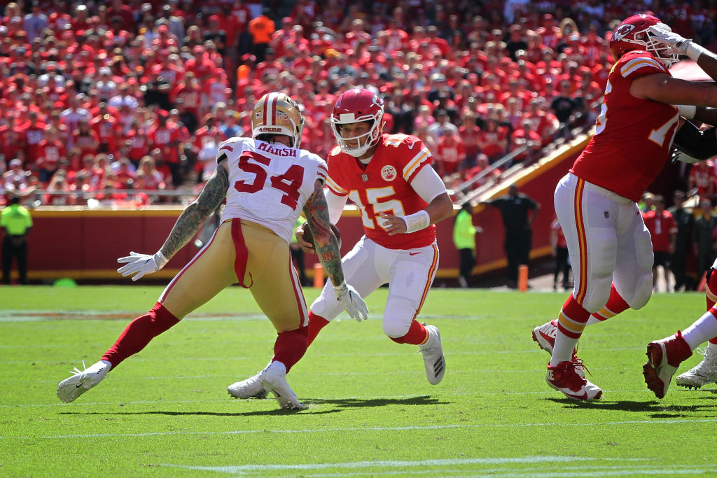 Kansas City Chiefs quarterback Patrick Mahomes takes a big hit from a 49ers defensive end in 2018