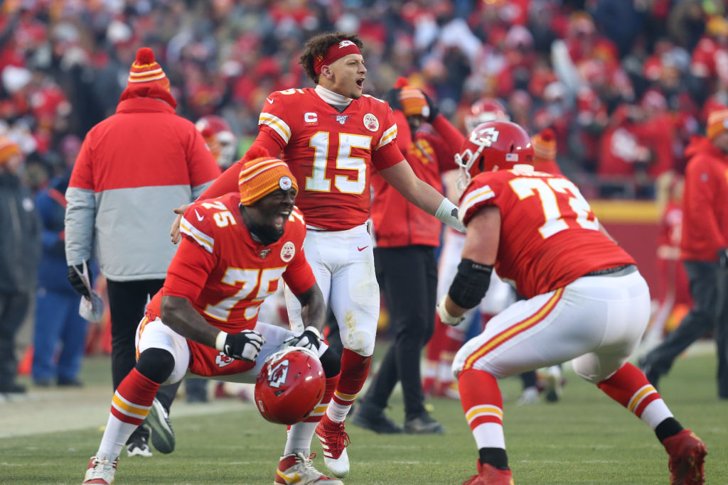 Kansas City Chiefs quarterback Patrick Mahomes, offensive tackles Cameron Erving and Eric Fisher celebrate late in the fourth quarter of the AFC Championship game