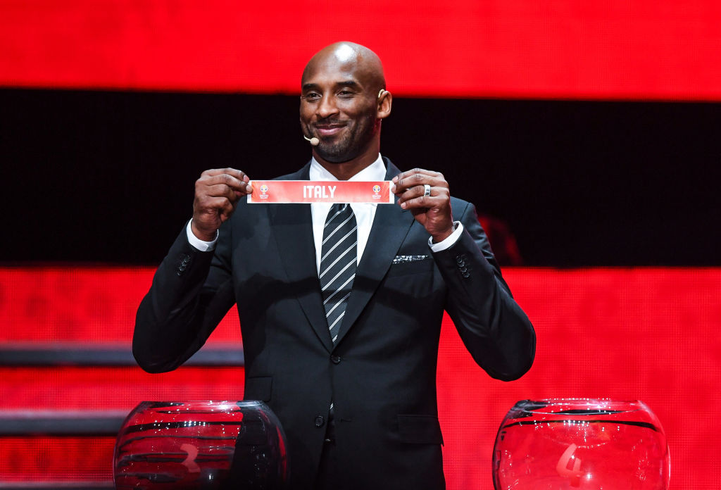 Kobe Bryant, World Cup Ambassador, shows a ticket of Italy in 2019