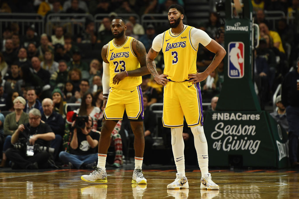 LeBron James and Anthony Davis of the Los Angeles Lakers wait for a free throw