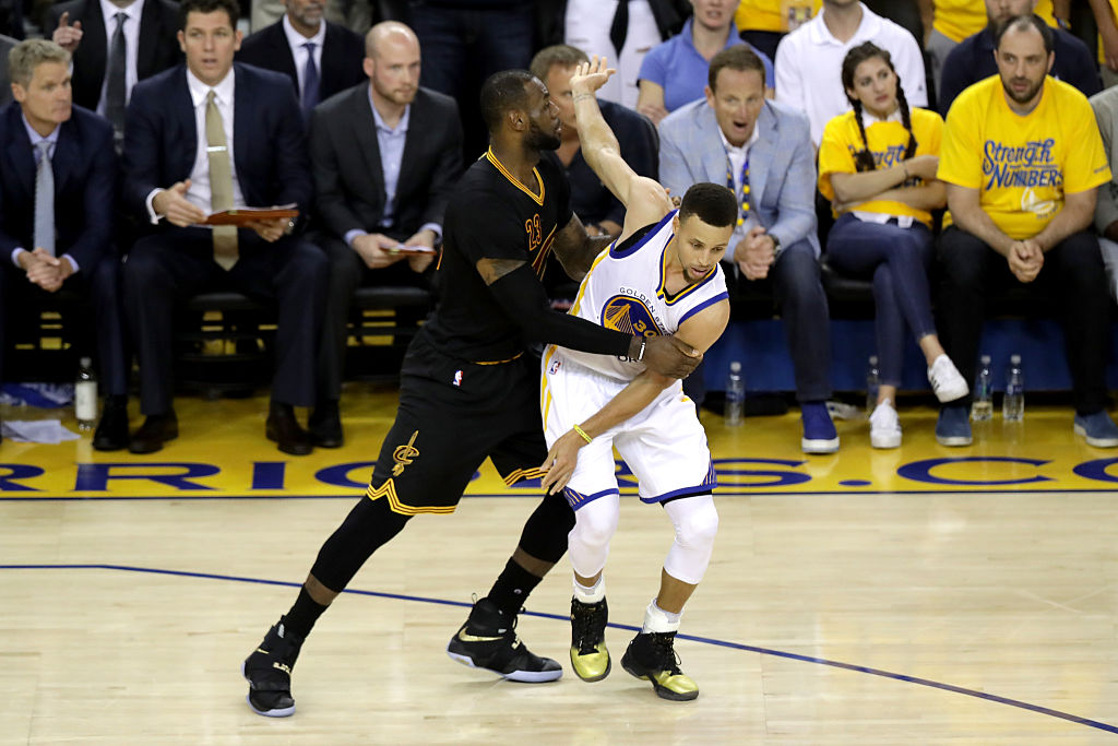 LeBron James of the Cleveland Cavaliers defends Stephen Curry of the Golden State Warriors in Game 7 of the 2016 NBA Finals