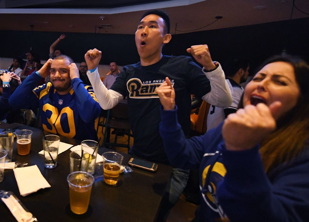 Los Angeles Rams fans reacts as they watch their team play in Super Bowl LII