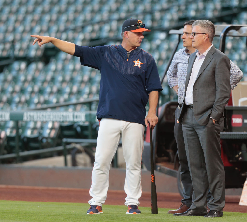 Manager A.J. Hitch of the Houston Astros and general manager Jeff Luhnow talk during batting practice in 2017