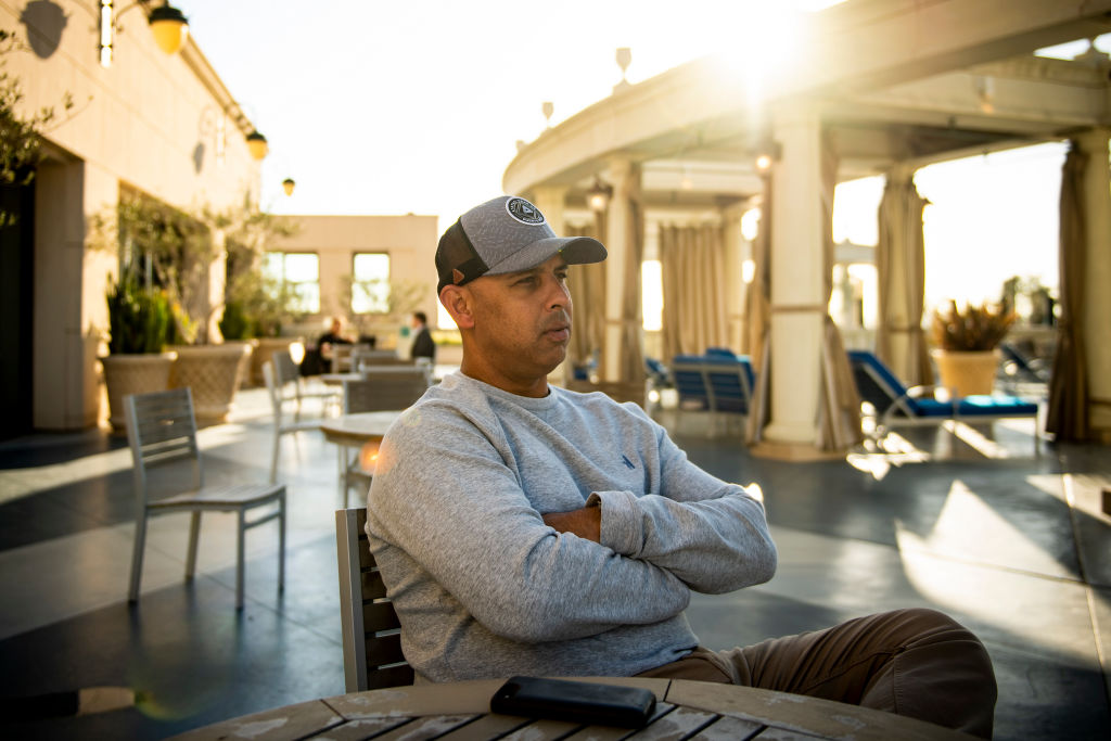 Manager Alex Cora of the Boston Red Sox looks on