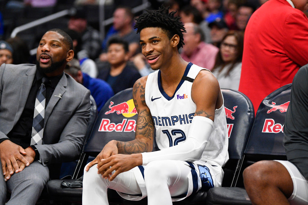 Memphis Grizzlies Guard Ja Morant looks on from the bench before an NBA game