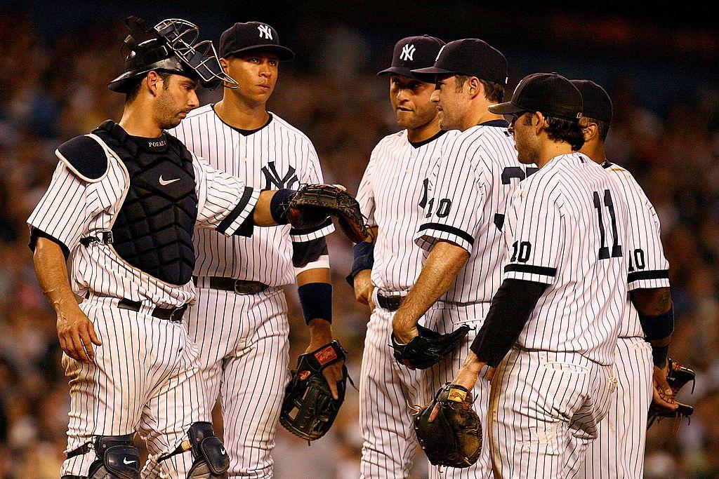 Mike Mussina, Jorge Posada, Alex Rodriguez, Derek Jeter, Doug Mientkiewicz, and Robinson Cano of the 2007 New York Yankees