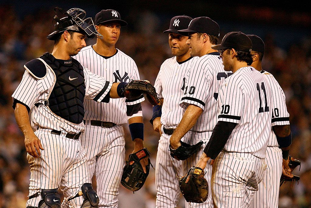 Mike Mussina, Jorge Posada, Alex Rodriguez, Derek Jeter, Doug Mientkiewicz, and Robinson Cano of the 2007 New York Yankees
