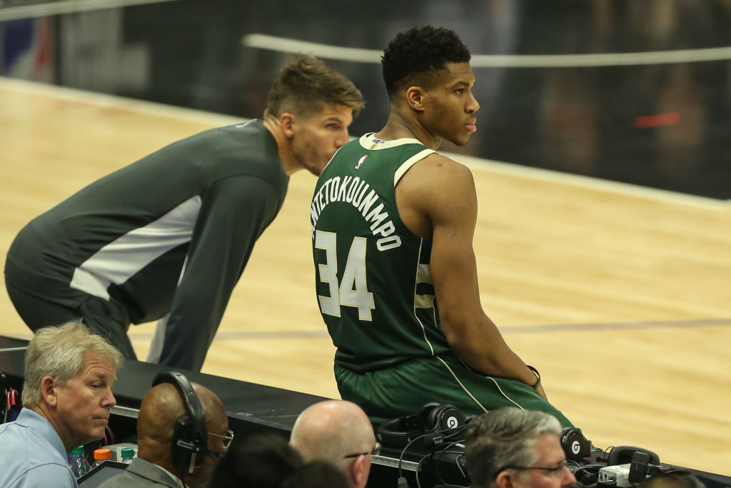 Milwaukee Bucks forward Giannis Antetokounmpo and Milwaukee Bucks guard Kyle Korver wait to come in during a game