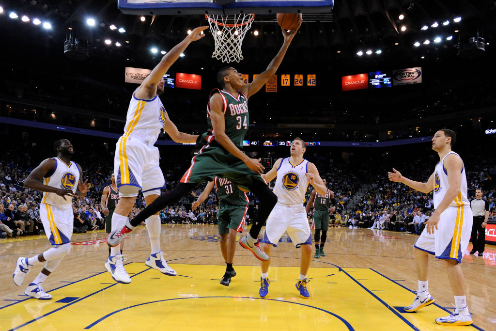 Milwaukee Bucks' Giannis Antetokounmpo goes up for a layup