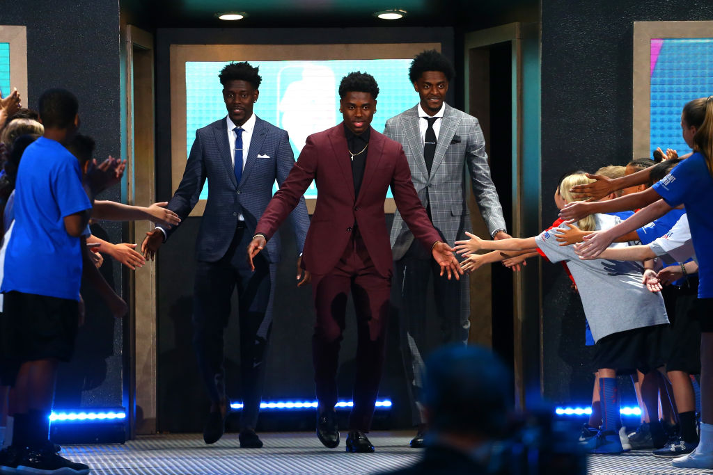 Draft Prospect Aaron Holiday (C) poses with brothers Justin Holiday and Jrue Holiday during the 2018 NBA Draft