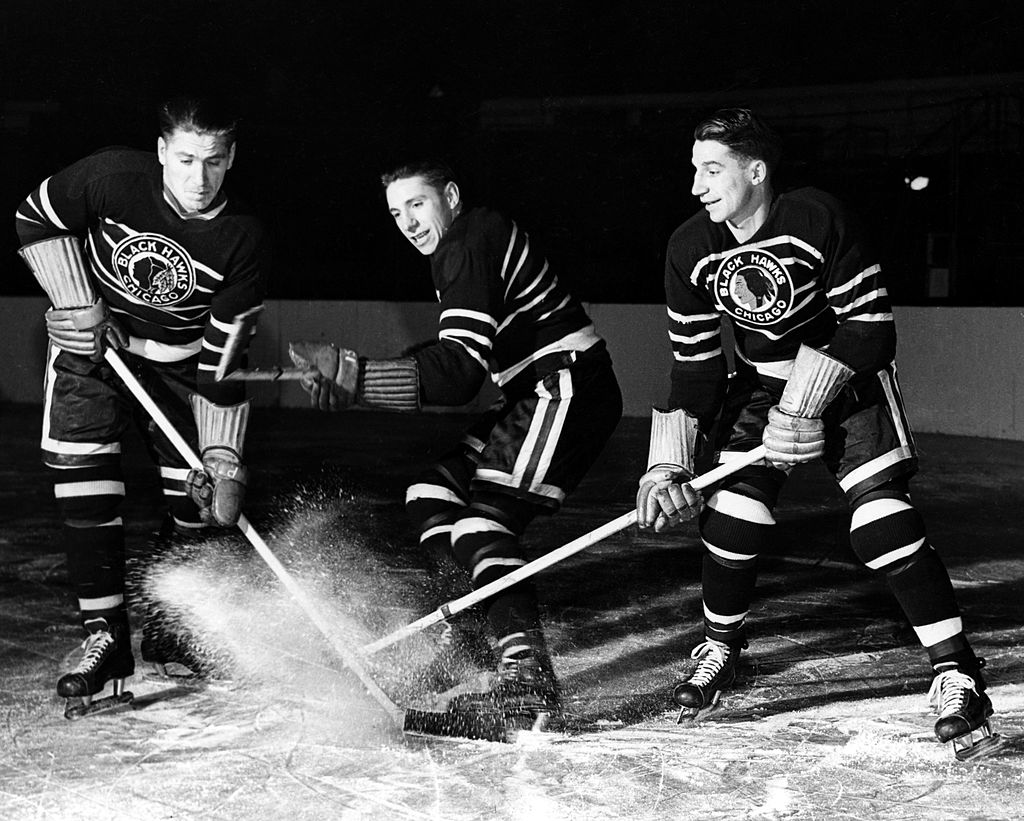 (L-R) Brothers Reg Bentley, Max Bentley and Doug Bentley of the Chicago Blackhawks pose on the ice on December 5, 1942