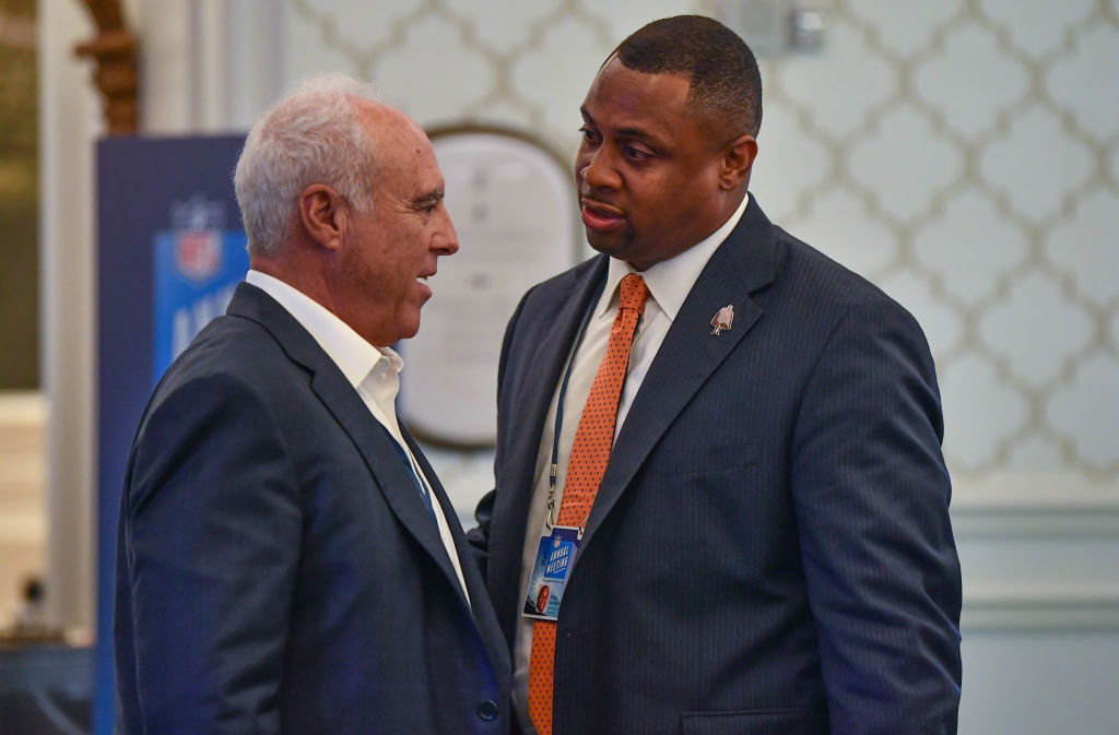 Philadelphia Eagles owner Jeffrey Lurie speaks with NFL Executive Vice President of Football Operations Troy Vincent after a meeting