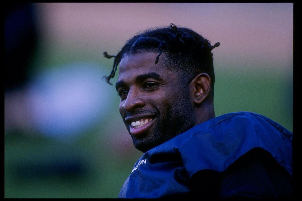 Outfielder Deion Sanders of the San Francisco Giants looks on during a game