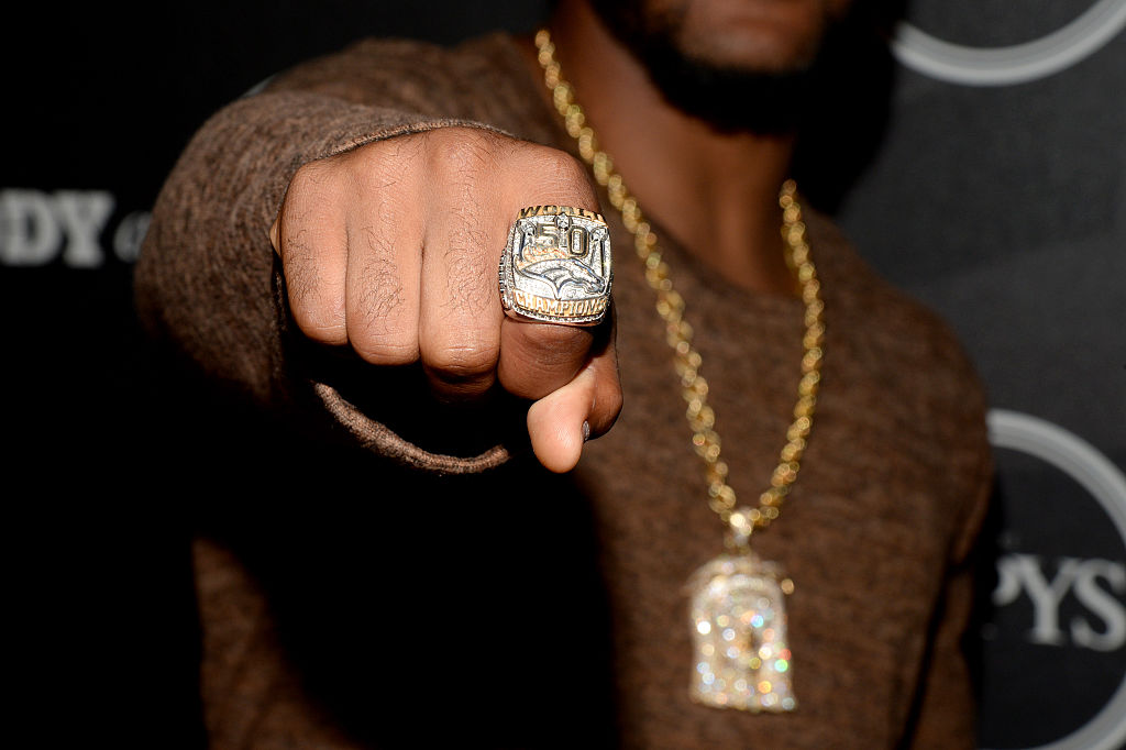 NFL player T. J. Ward shows off his Super Bowl 50 ring