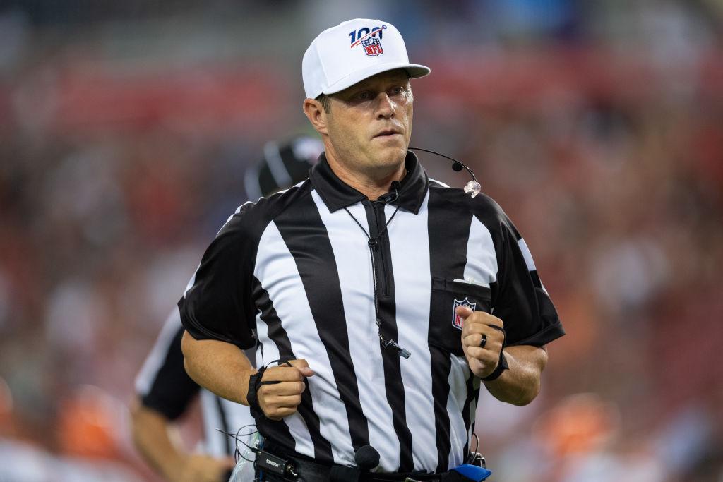 NFL referee Craig Wrolstad, jogs to the sideline