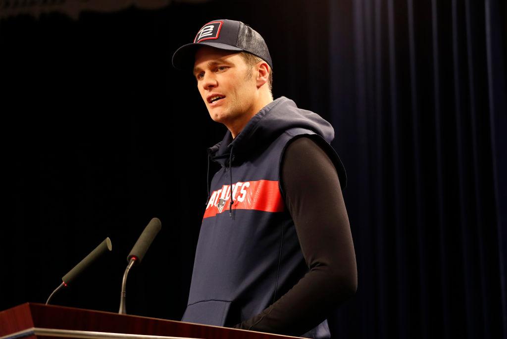 New England Patriots quarterback Tom Brady (12) fields a question during press conferences