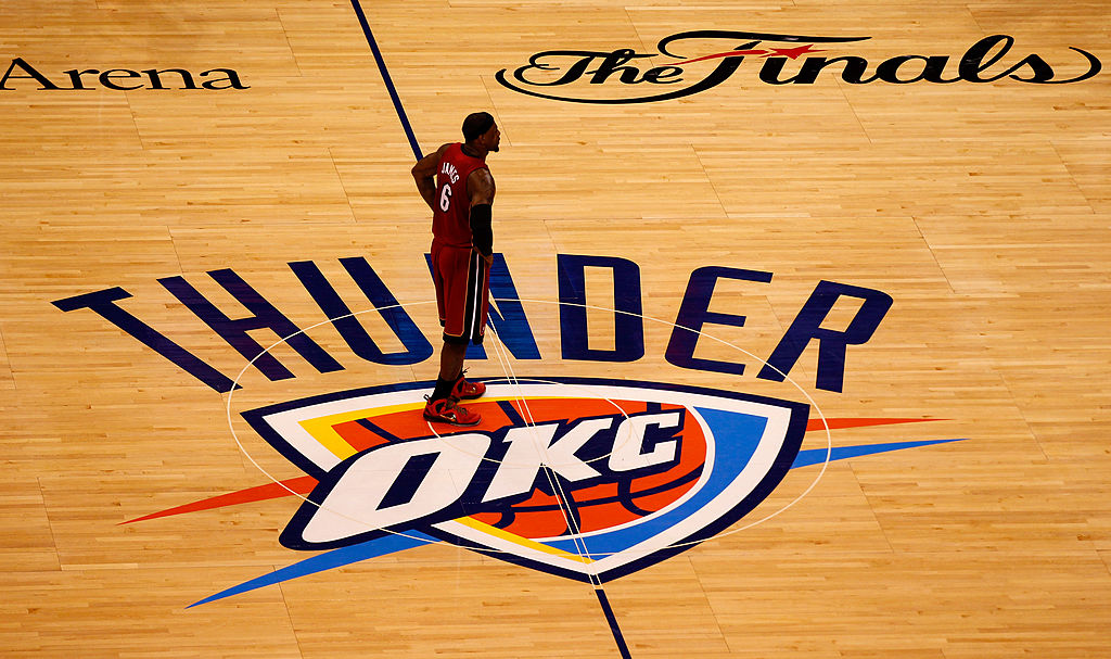 The Oklahoma City Thunder logo is seen on the court