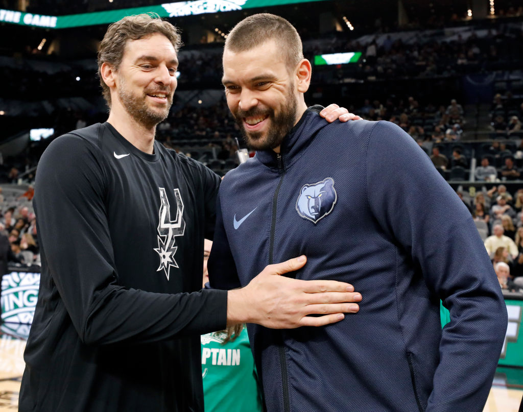 Pau Gasol of the San Antonio Spurs talks with his brother Marc Gasol of the Memphis Grizzlies