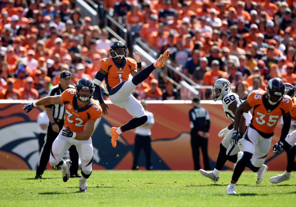 Punter Marquette King of the Denver Broncos kicks the the ball