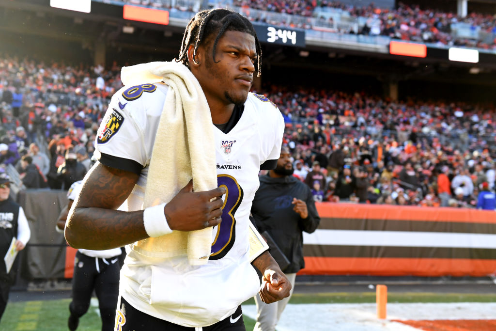 Quarterback Lamar Jackson of the Baltimore Ravens runs onto the field at halftime