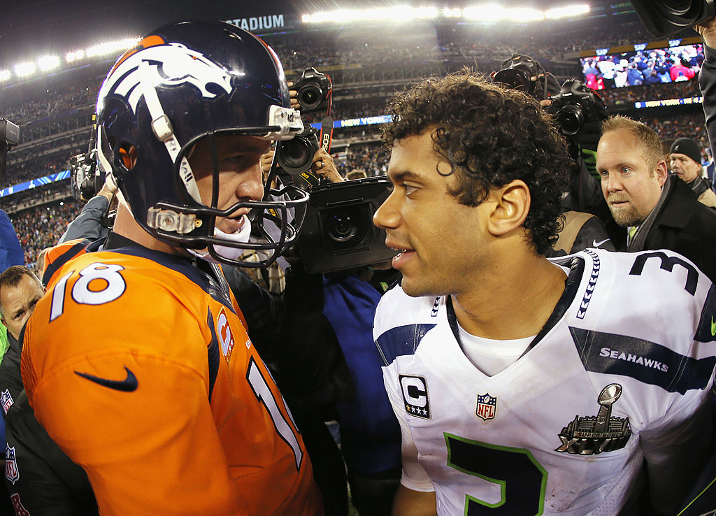 Quarterback Peyton Manning of the Denver Broncos congratulates quarterback Russell Wilson of the Seattle Seahawks after Super Bowl XLVIII