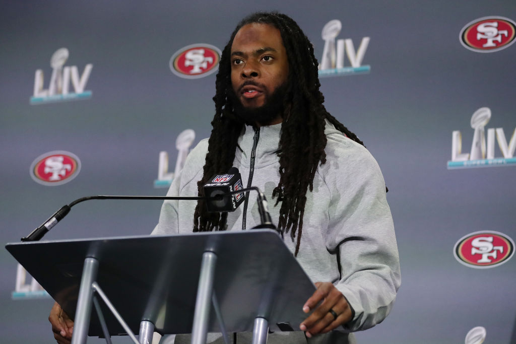 Richard Sherman of the San Francisco 49ers speaks to the media