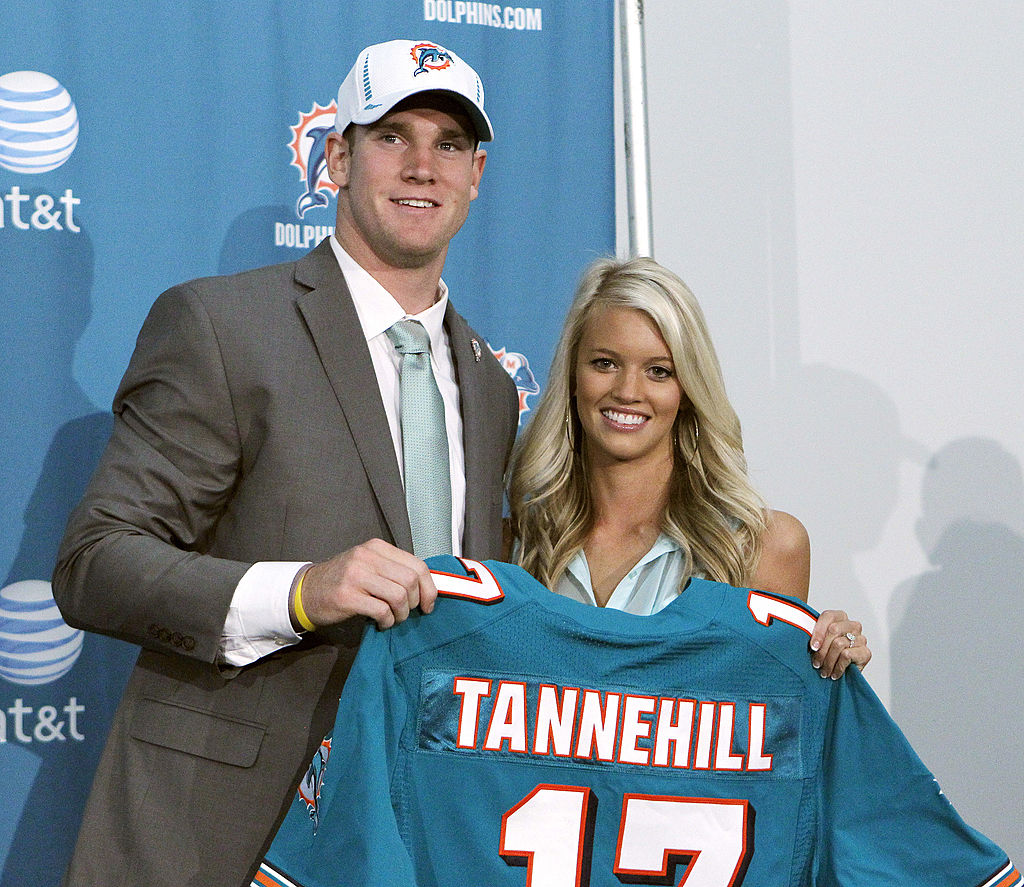 Ryan Tannehill and his wife Lauren hold his new Dolphins jersey