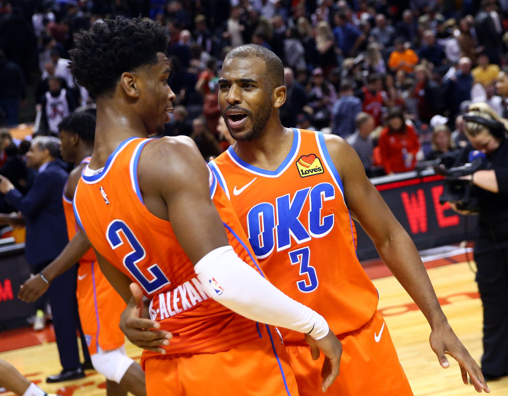 Shai Gilgeous-Alexander of the Oklahoma City Thunder is congratulated by teammate Chris Paul