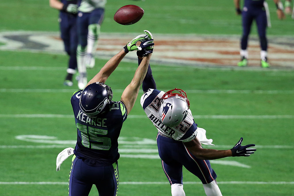 Strong safety Malcolm Butler of Patriots defends wide receiver Jermaine Kearse of the Seahawks during Super Bowl XLIX