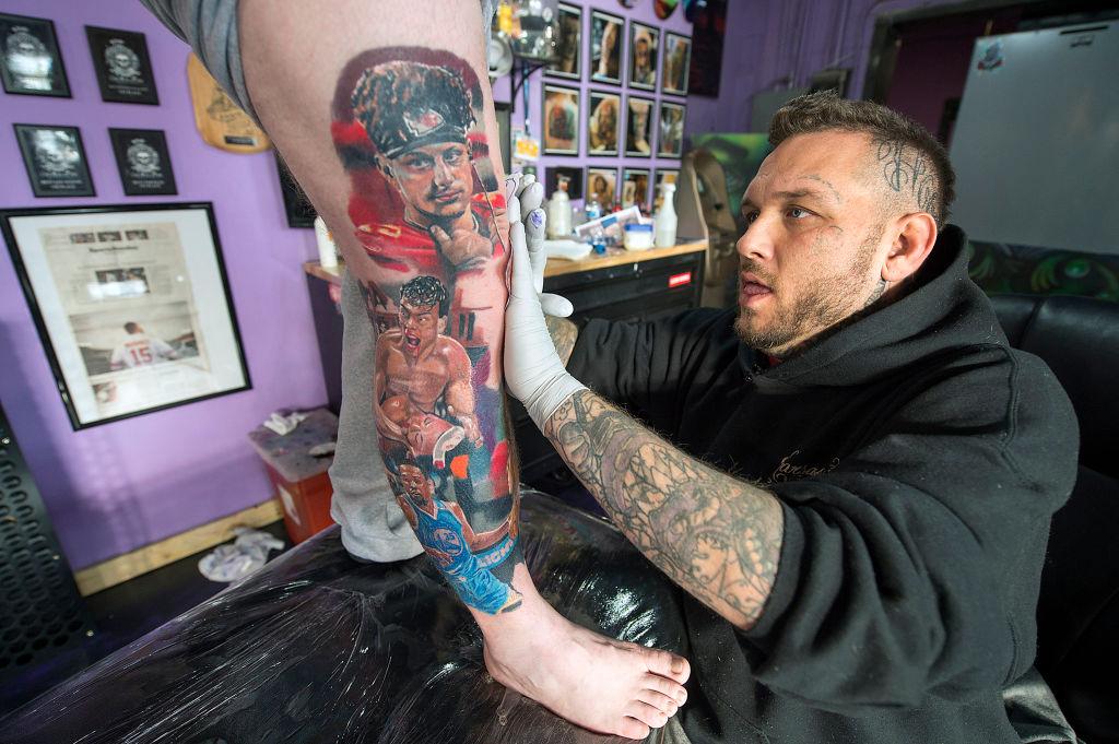 Tattoo artist Jeremy Taylor inks a portrait of Kansas City Chiefs Patrick Mahomes