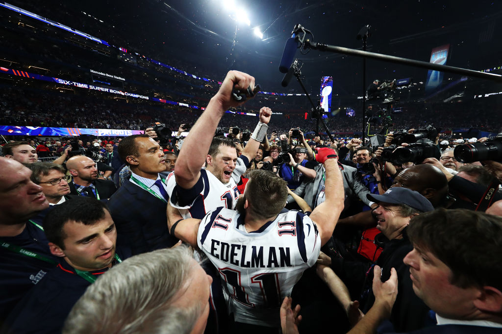 Tom Brady of the New England Patriots and Julian Edelman celebrate winning Super Bowl LIII